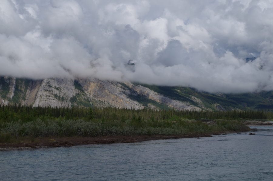 View Of Medicine Lake, Trees, Mountains, And Clouds
