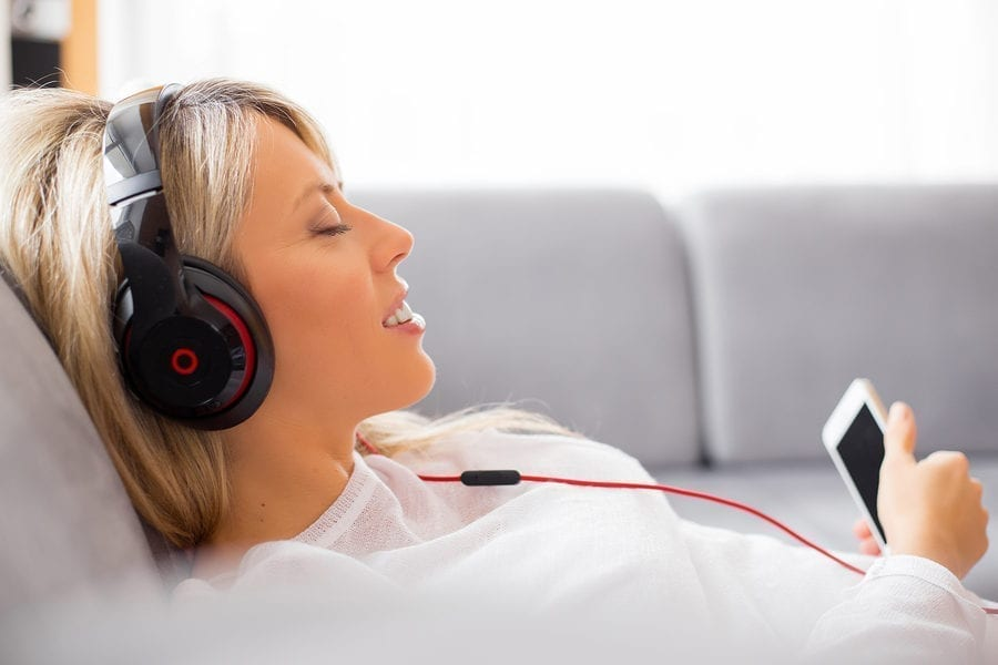 Woman Listening To Zen12 Meditation