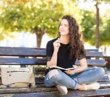 Woman Focusing On Journal Prompts